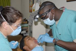 two dentists attending to a patient