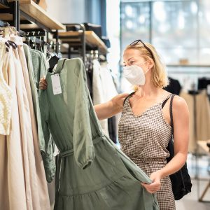 Woman checking out a dress in a clothing store in Willows